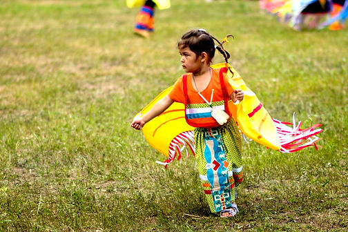 Kaboni Pow Wow young girl in orange ribb