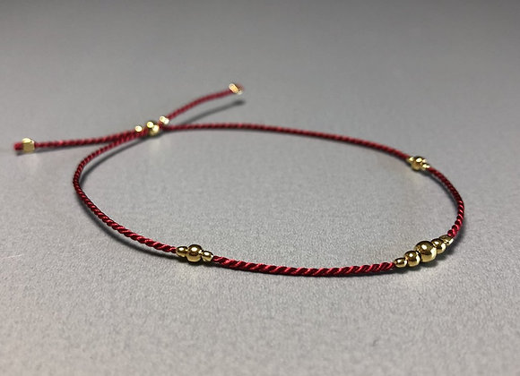 Seidenarmband rot mit Charms in gold oder silber