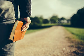 man-holding-a-Bible-at-his-side-looking-