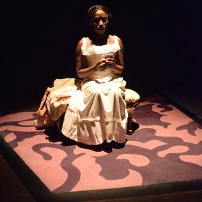 Elizabeth sitting in light