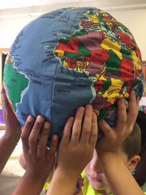 children holding the world.jpg