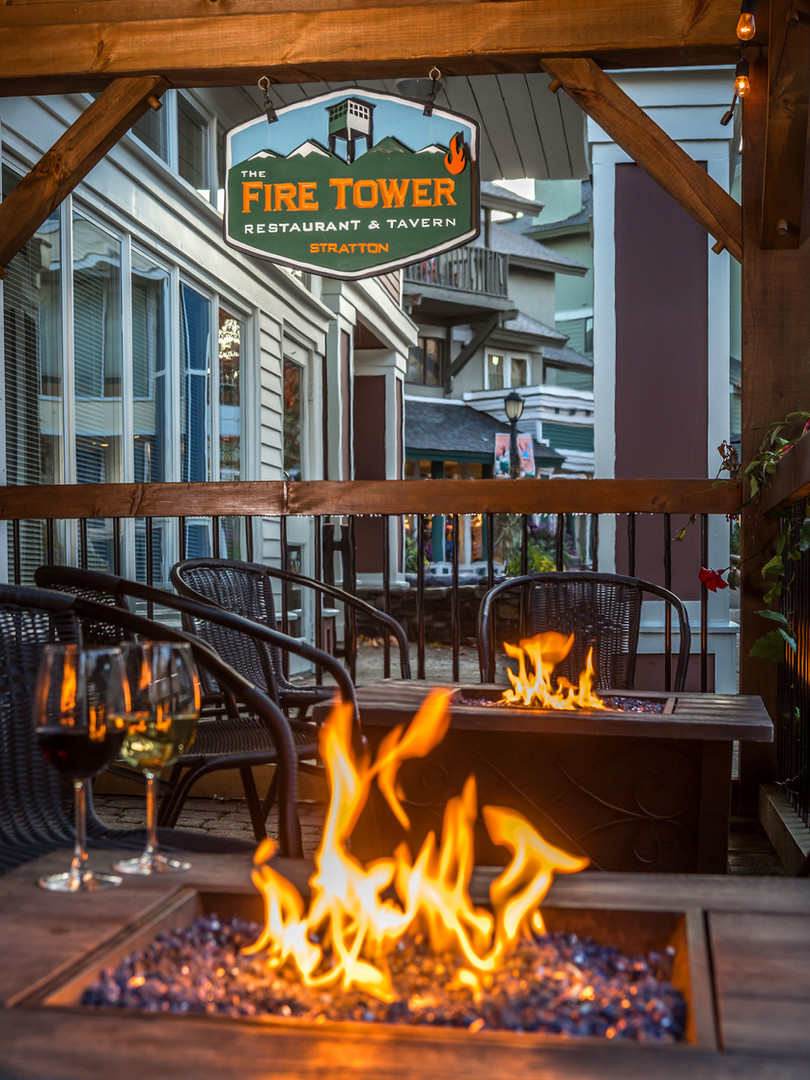 Enjoy a cocktail by the firepits on the patio