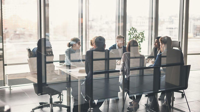 photo-header-team-meeting-through-window