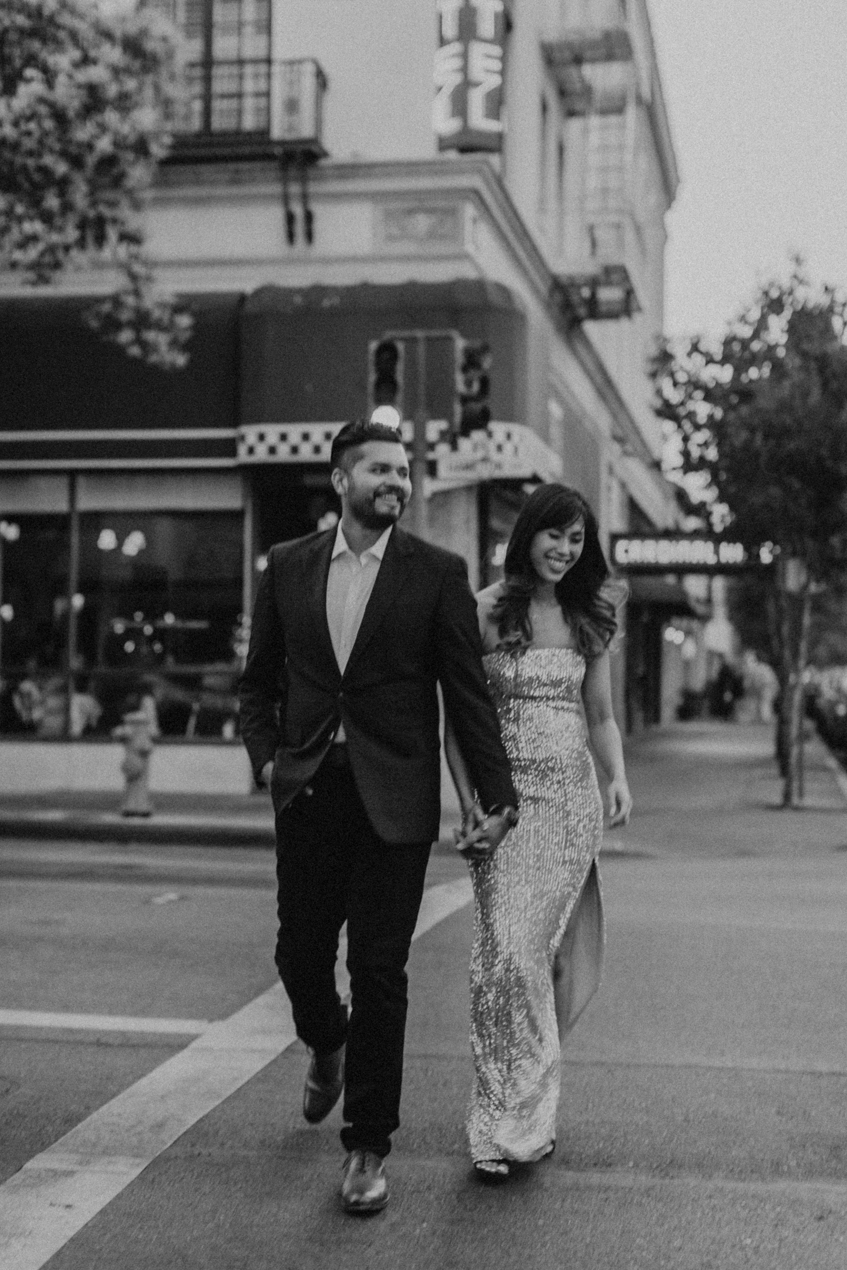 downtown engagement photos couple crossing street