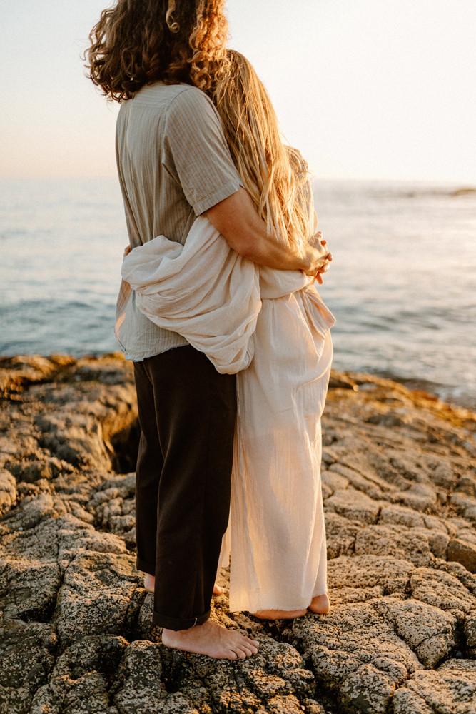 couple hugging orange county engagement photographer