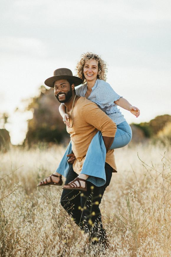 piggyback ride engagement photo