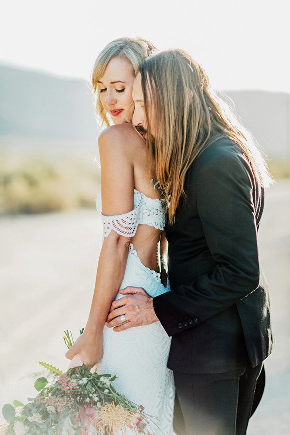 groom kissing brides shoulder sweet pose