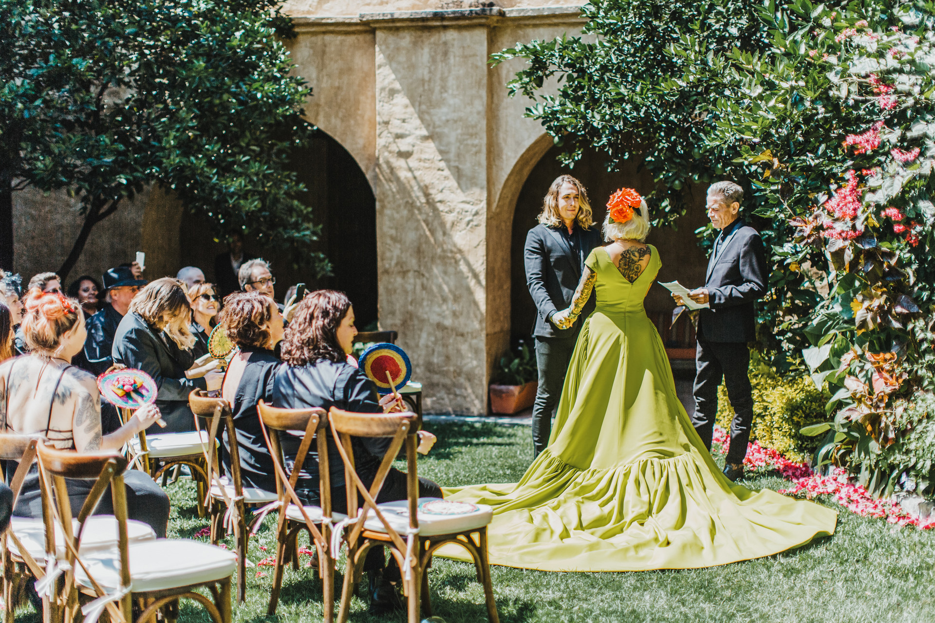 bride wearing custom chartreuse gown with long train
