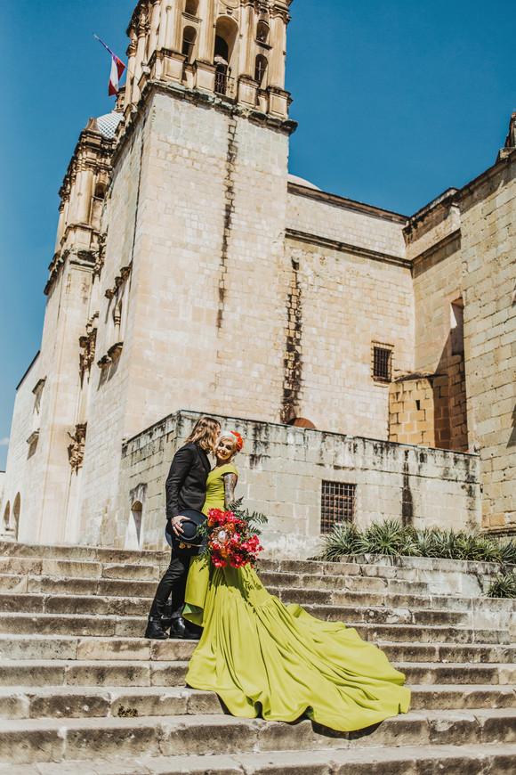 bride and groom on steps of Church of Santo Domingo de Guzmán