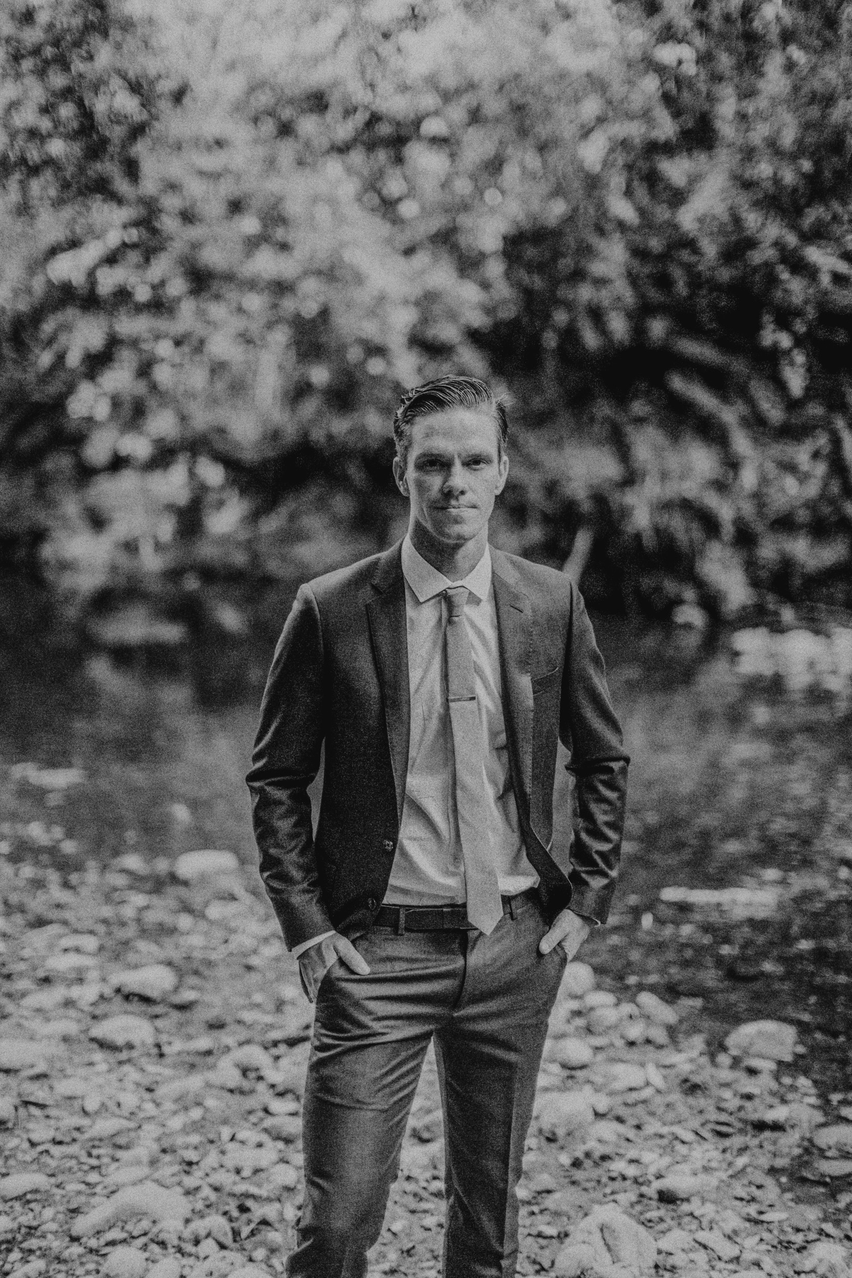 groom standing along creek glen oaks big sur