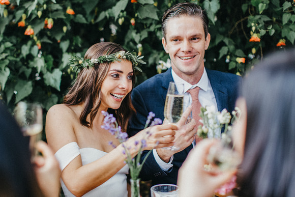 bride and groom toasting with guests big sur bakery