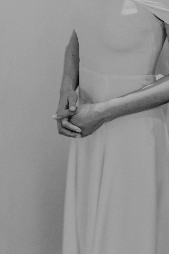 bohemain bride wearing simple reformation wedding dress