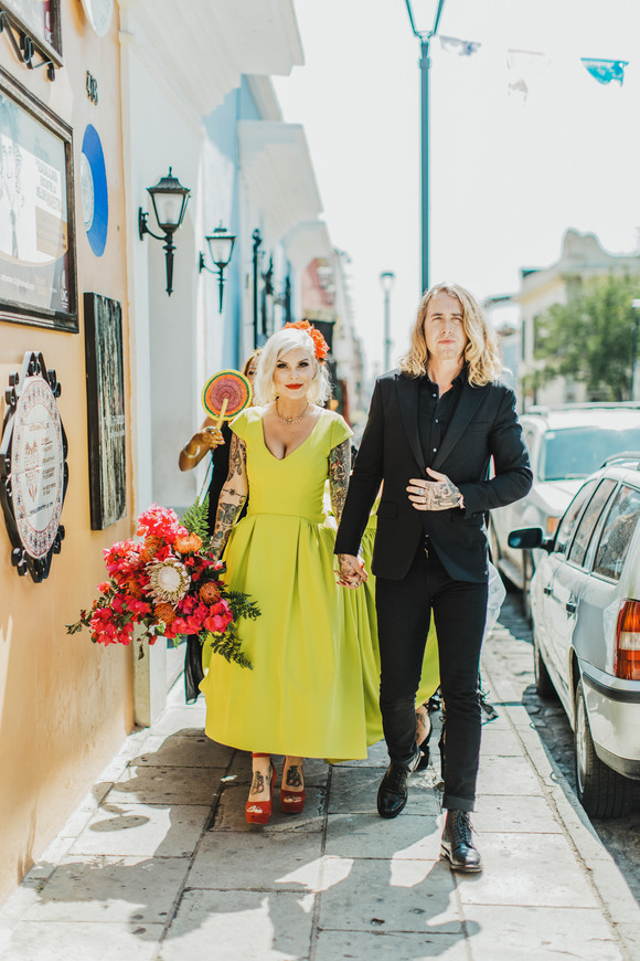 bride and groom walking through oaxaca city mexico