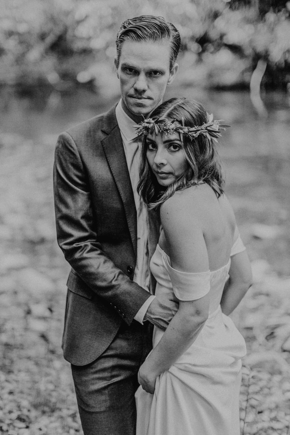 bride and groom serious black and white portrait