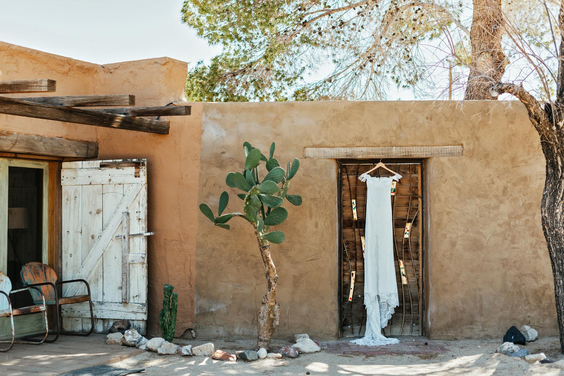 grace loves lace dress hanging in desert setting