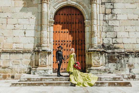 wedding photos at doors of Church of Santo Domingo de Guzmán