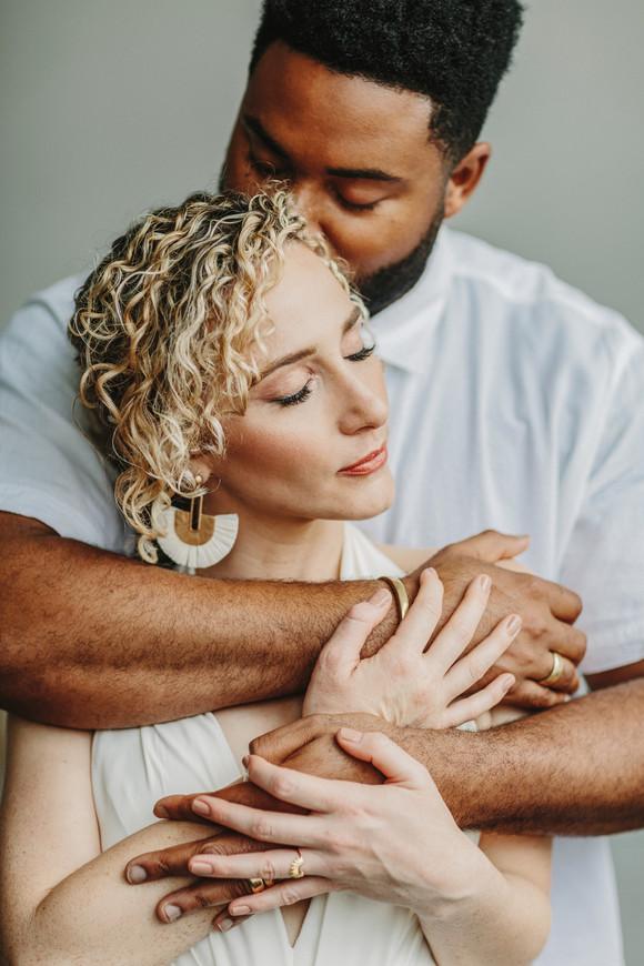 groom kissing side of bride's head