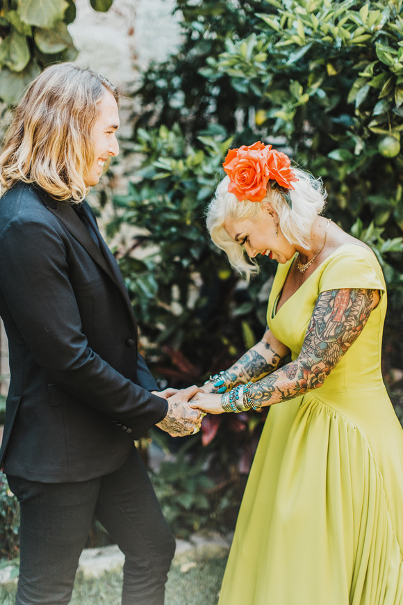 alternative bride laughing with groom