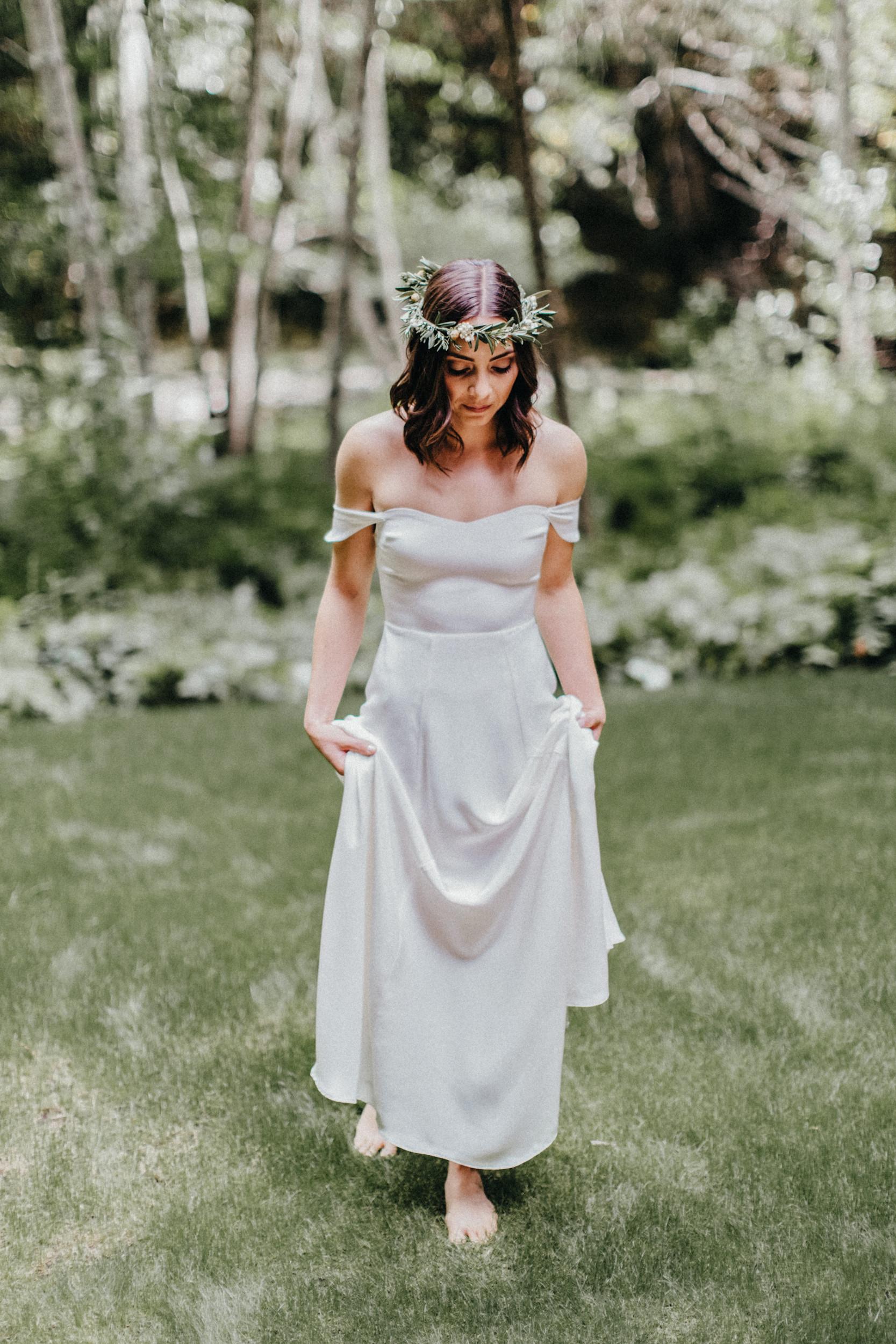 big sur bride wearing simple off the shoulder dress