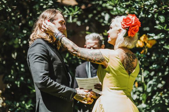 bride brushing groom's hair away from face