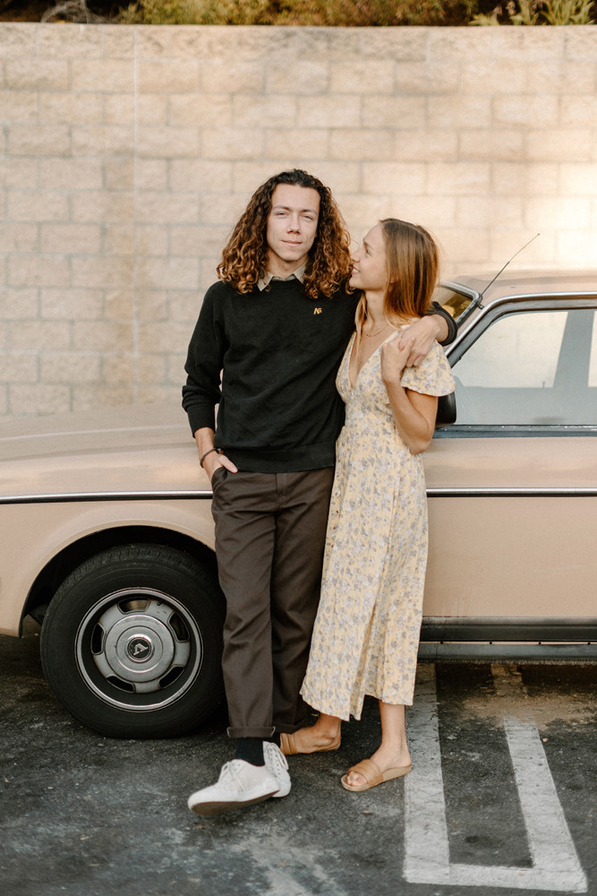 parking lot engagement photos station wagon