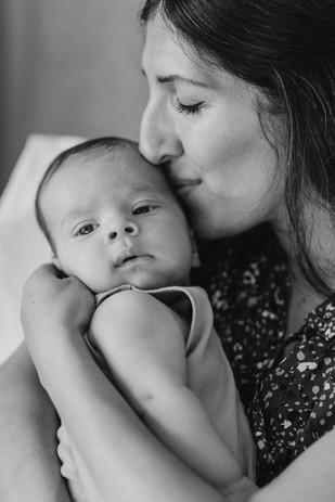 mom kissing baby's cheek newborn photos