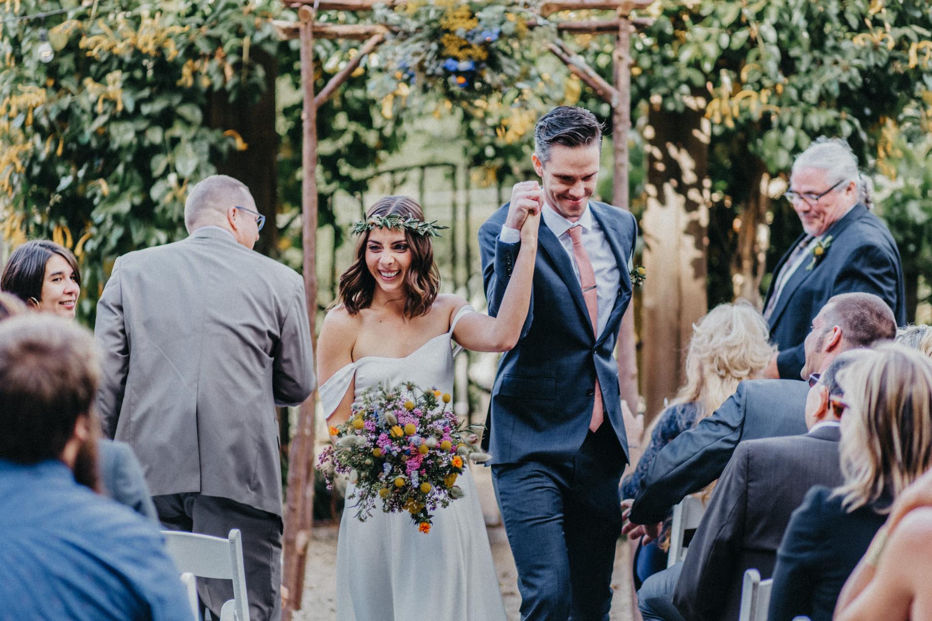 bride and groom walking down aisle big sur bakery wedding