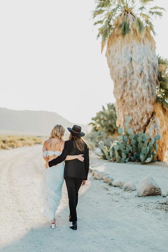 bride and groom walking in desert 29 palms inn