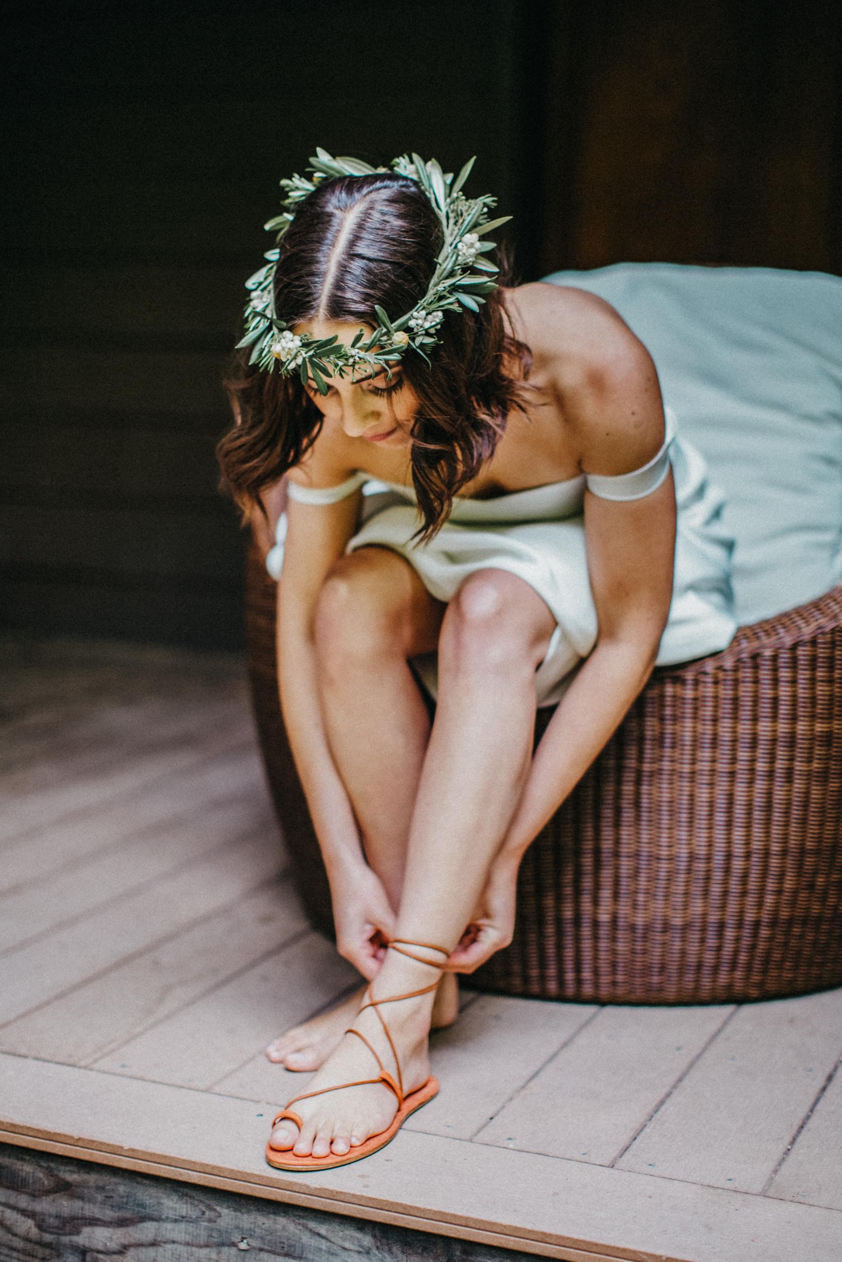bride wearing tie up sandals