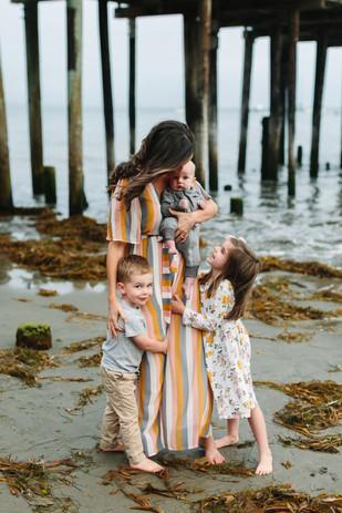 kids hugging mom huntington beach pier photography