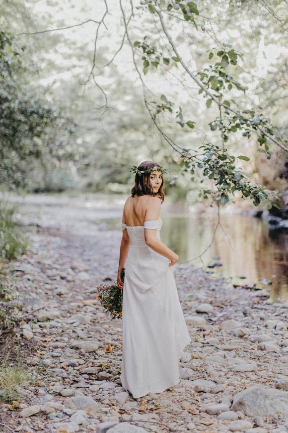 bride walking along creek glen oaks big sur