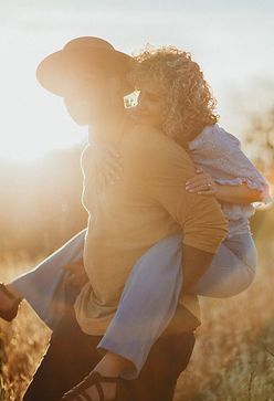 couple piggyback engagement photos