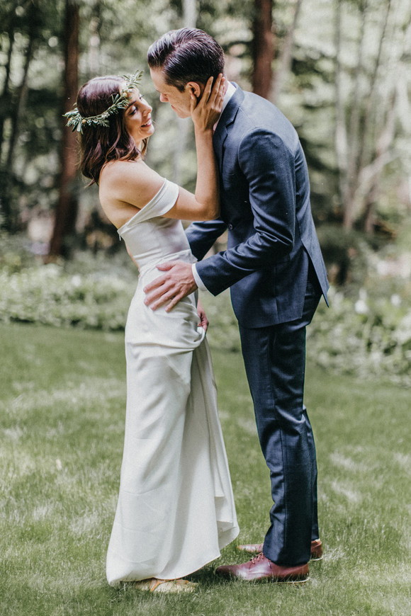 bride embracing groom during first look big sur elopement