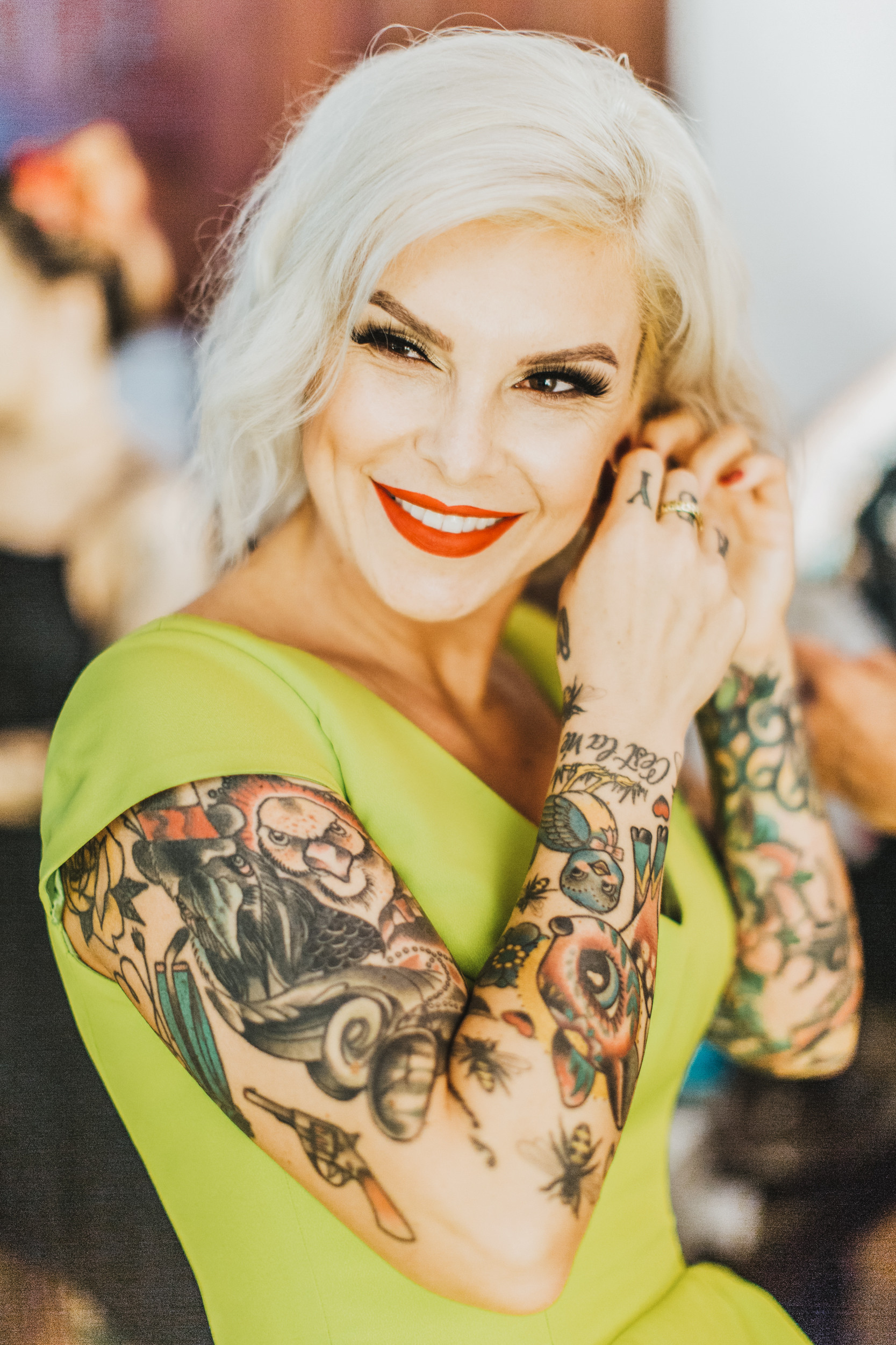 tattooed bride putting on earrings