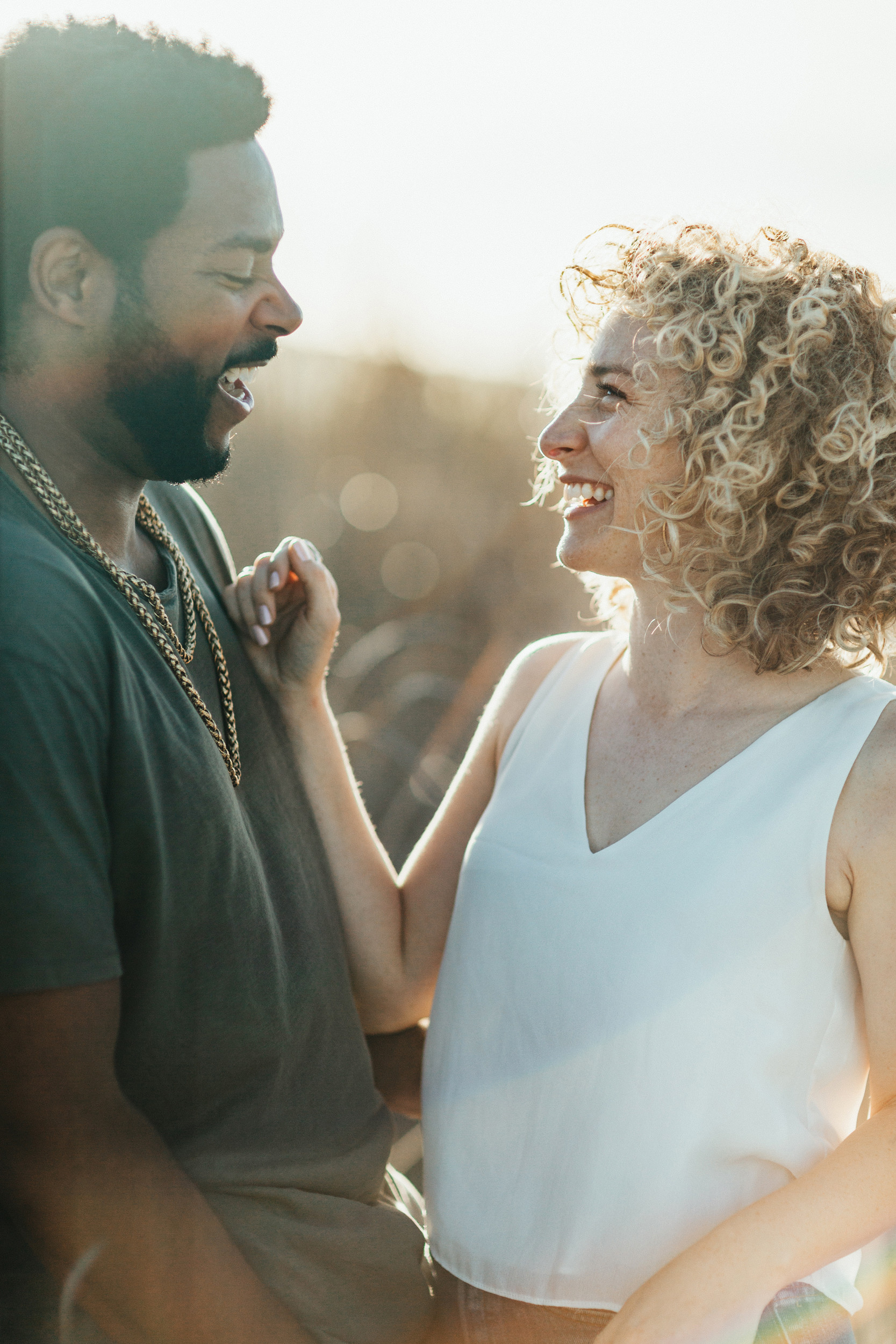 girl laughing with guy engagement photos