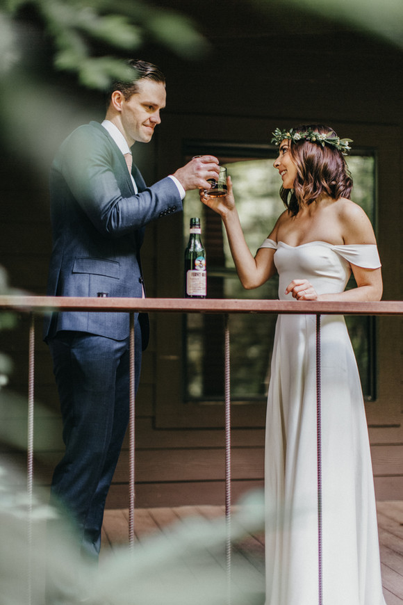 bride and groom toasting after first look
