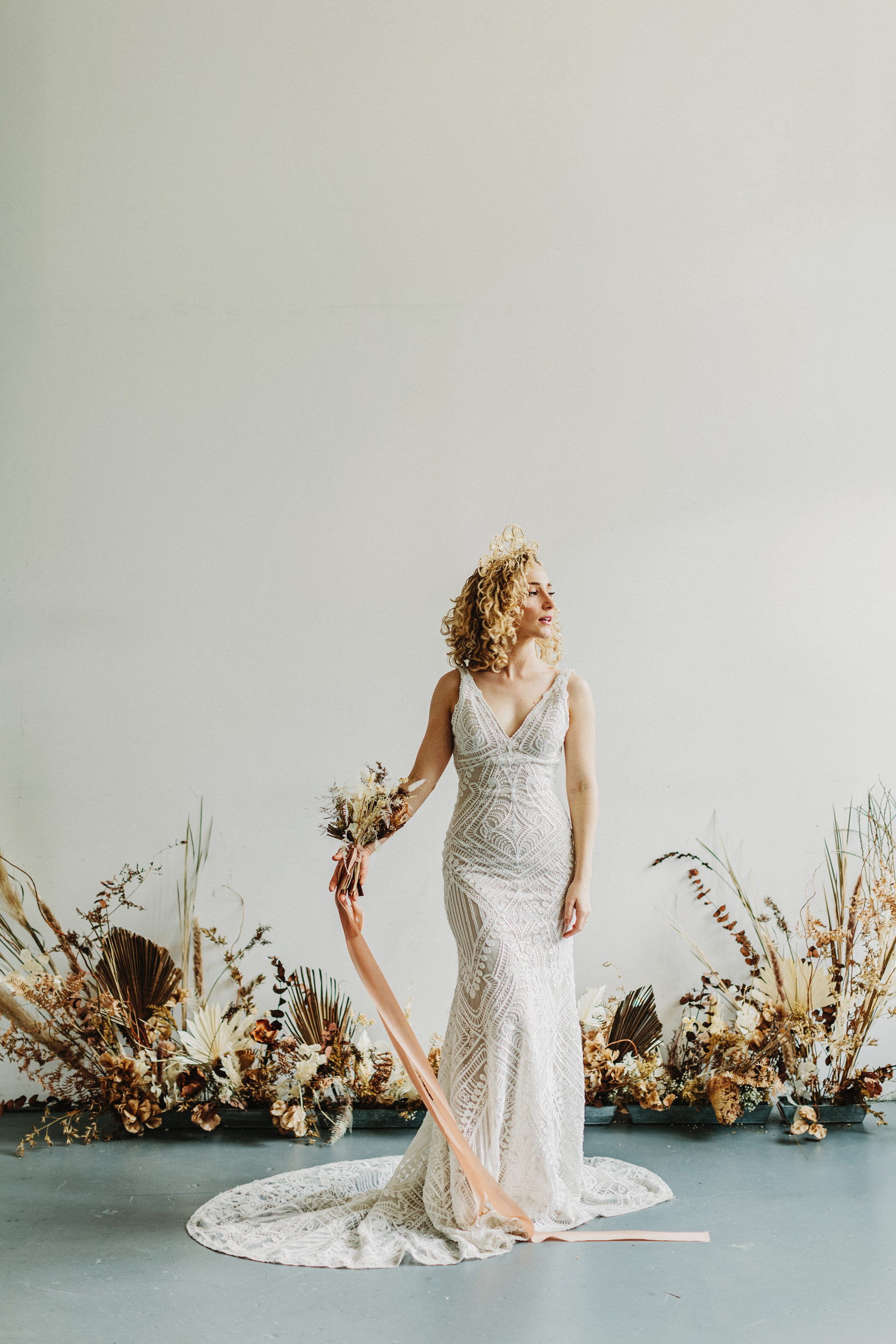 bride with curly hair and lace dress