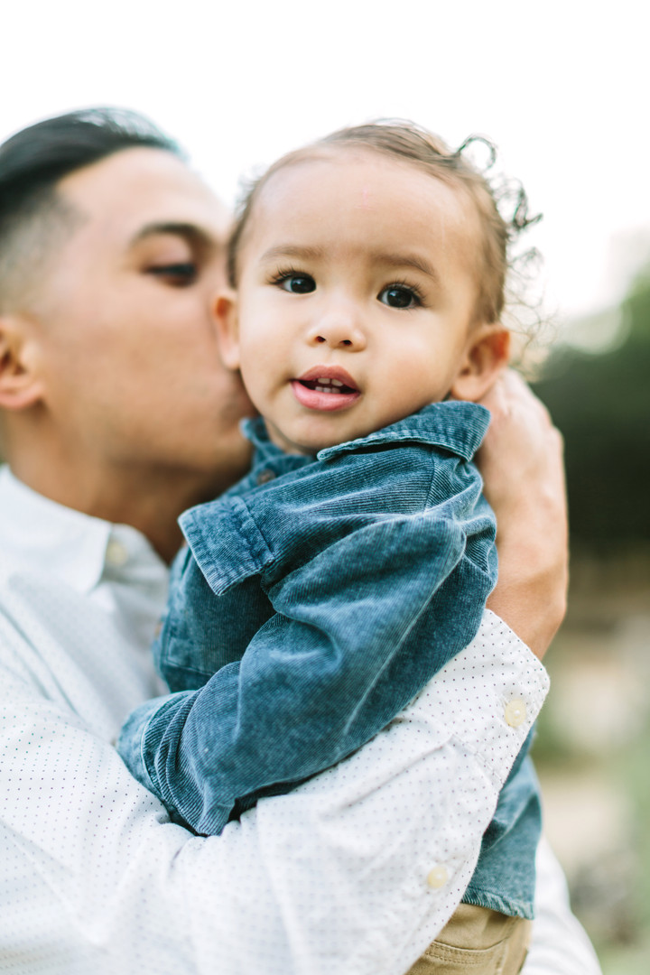father kissing son's cheek orange county photographer