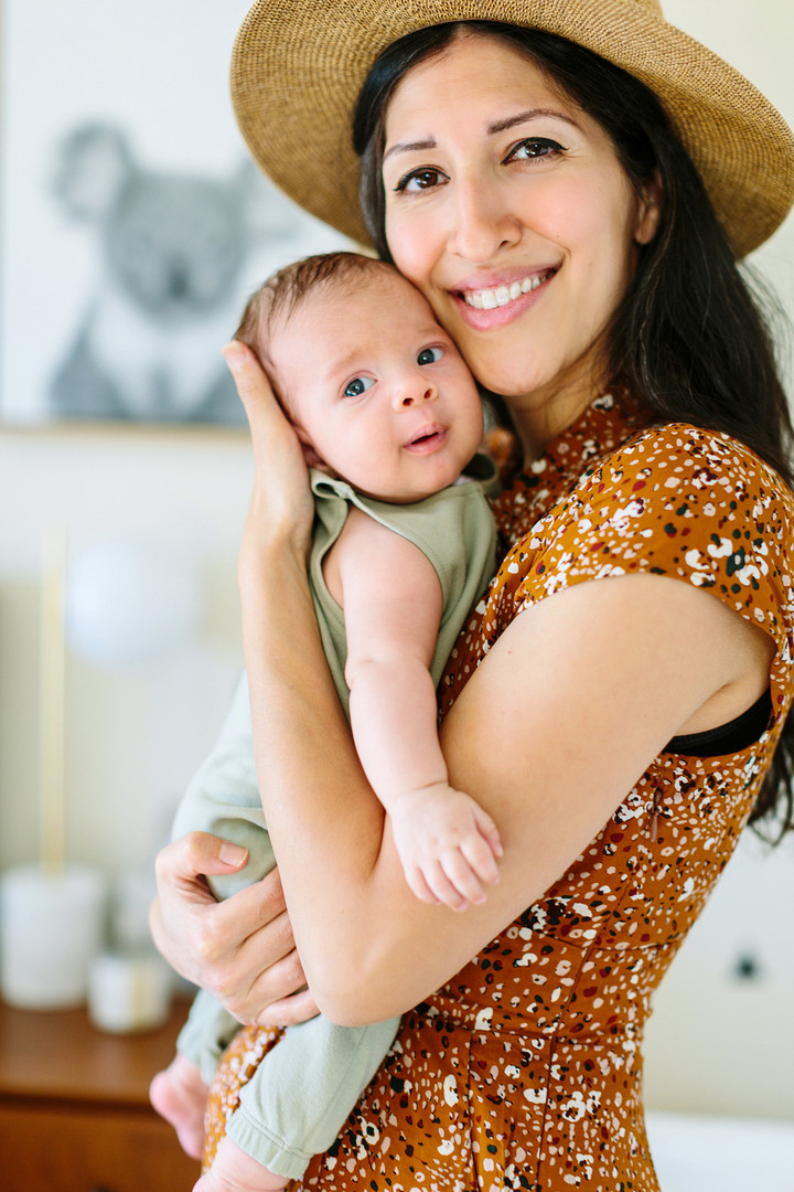 mom hugging newborn baby lifestyle photography