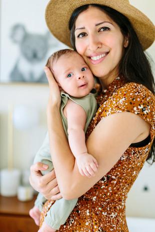mom hugging newborn baby lifestyle photography