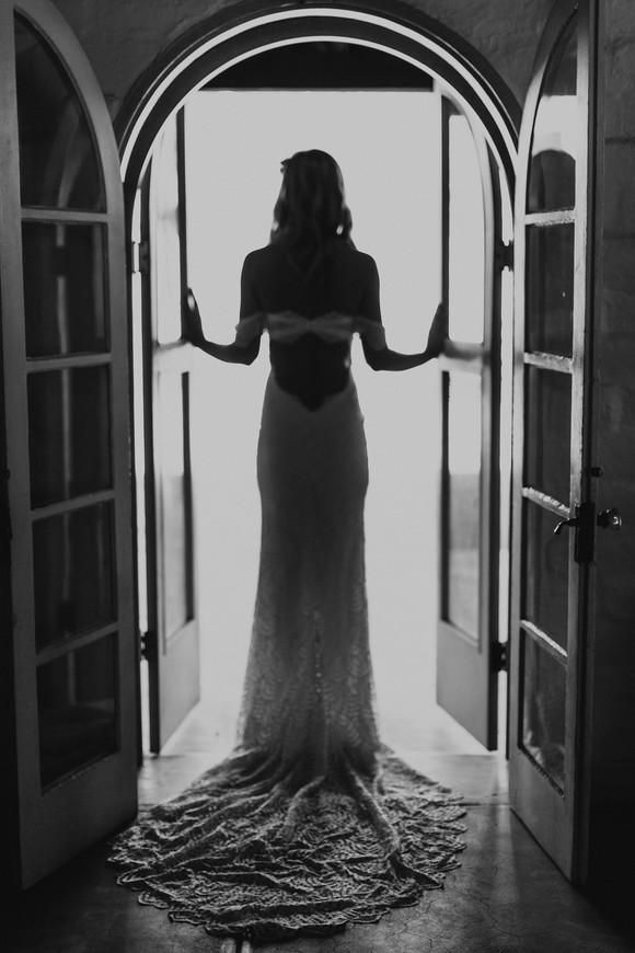 bride silhouette wearing grace loves lace dress