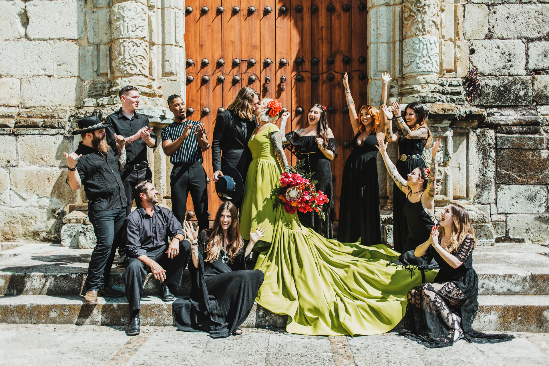 bridal party wearing all black fun group photo