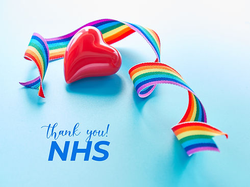 Red heart and rainbow ribbon, symbols of public support of NHS medical teams fighting pand