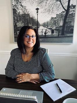 Megan Shields sitting at desk