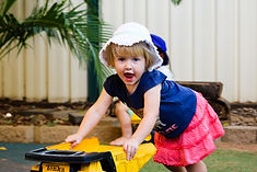 Little girl playing with truck