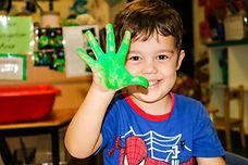 Little boy green paint