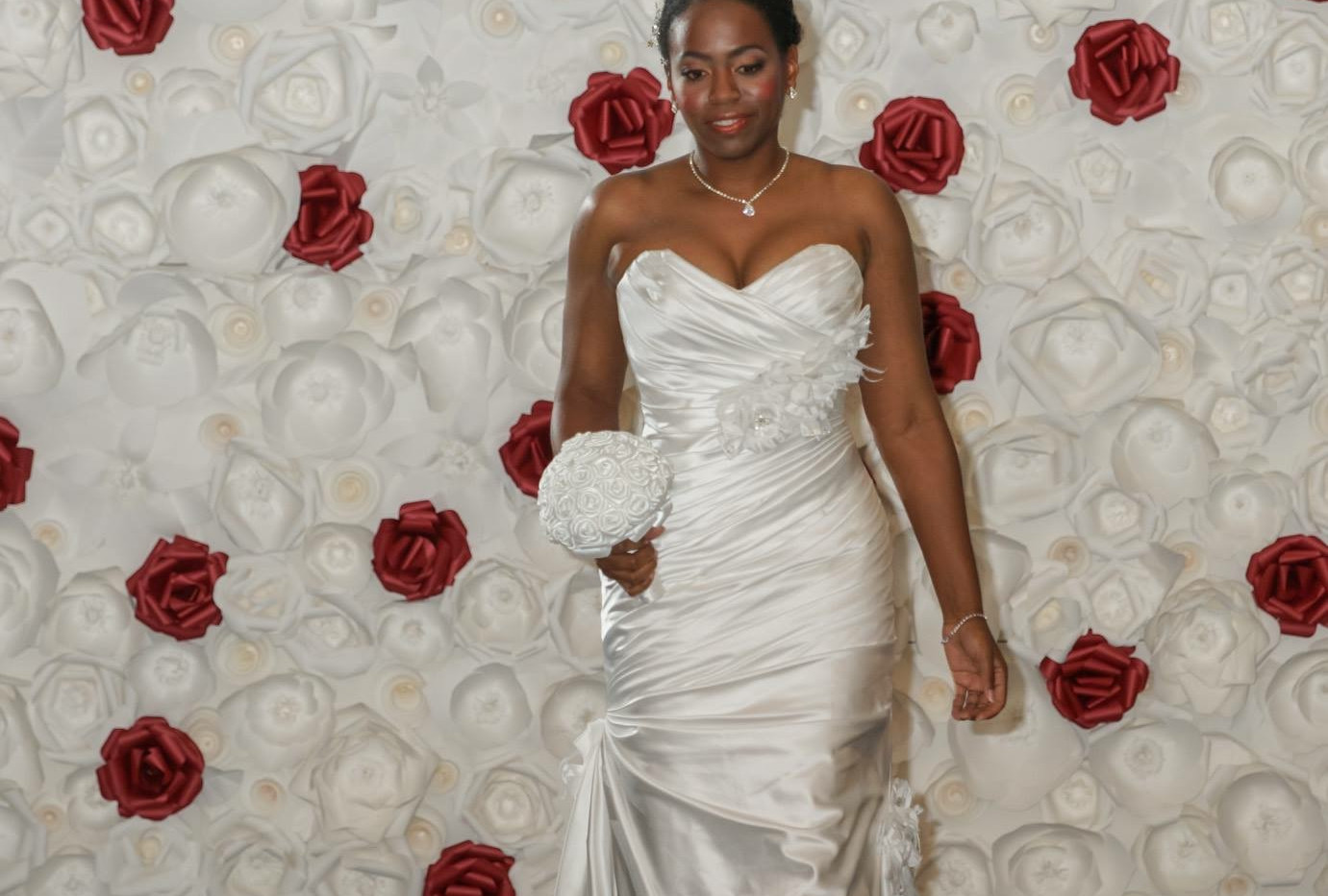 All White Backdrop With Red Roses