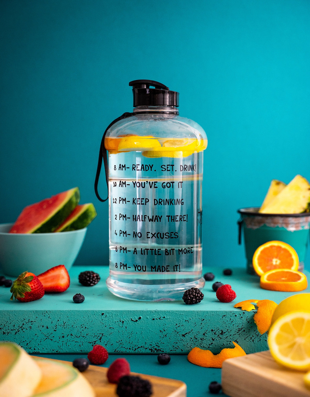 A bottle full of water and slices of fruit