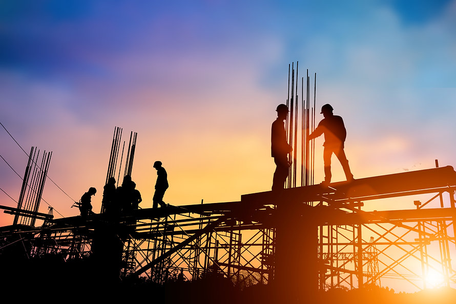 Silhouette engineer standing orders for construction crews to work on high ground  heavy i