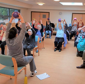 Day centre seated exercise class in Milton Kenes with 1st Step Rehab Fitness Support